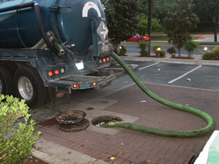 Pump truck cleaning out a grease trap